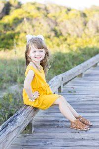girl yellow dress boardwalk